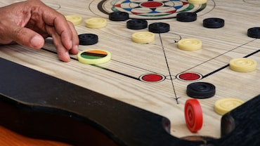Bond With Family And Friends Over A Game Of Carrom